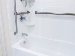 Bathtub and Shower with Metal Handrails