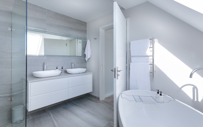 bathroom interior with white toilet sink and bathtub