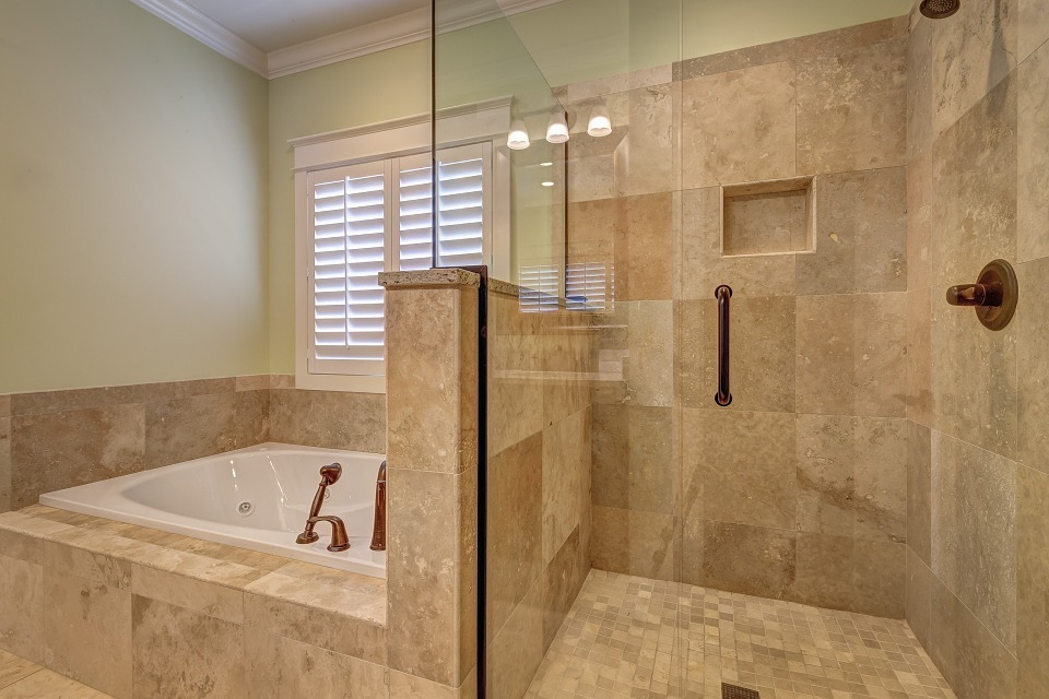modern bathroom with brown tiles and bathtub