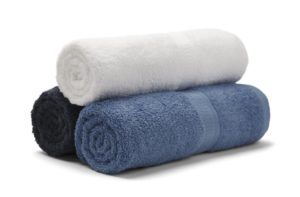 Three rolled up towels in a stack