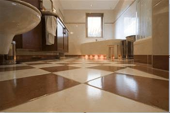 View of bathroom floor and bathtub