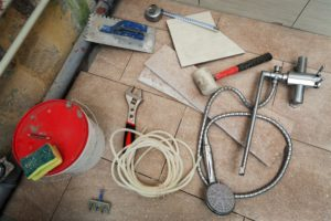 Tools on the floor of bathroom during remodel