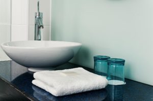 Modern bathroom sink with towel
