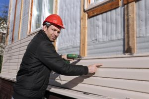 Man in Construction Hat Renovating House