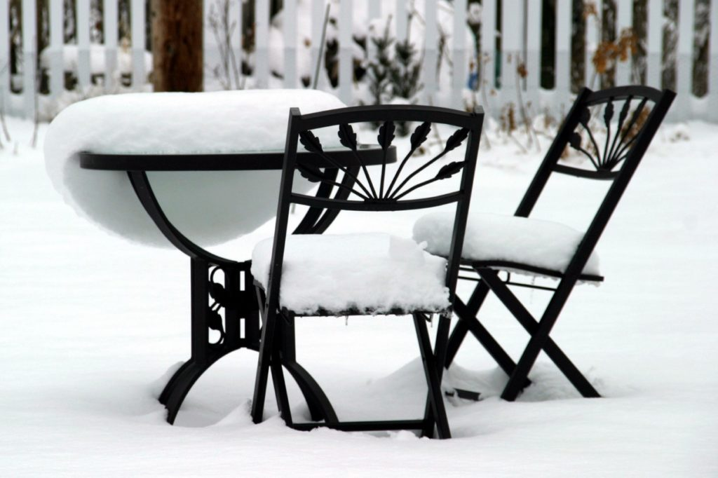 Snow on outside table and chairs
