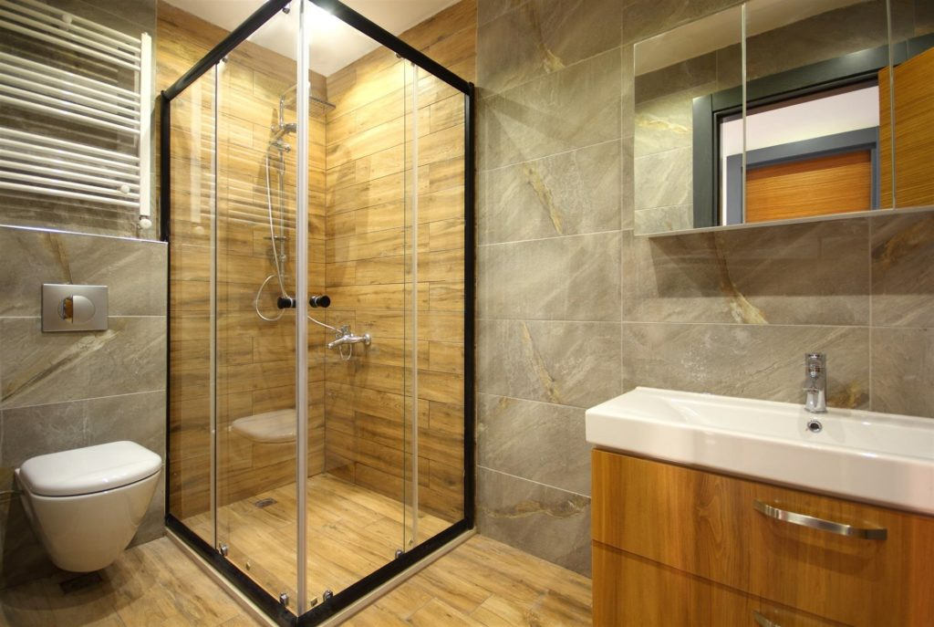 Custom fit shower enclosure
