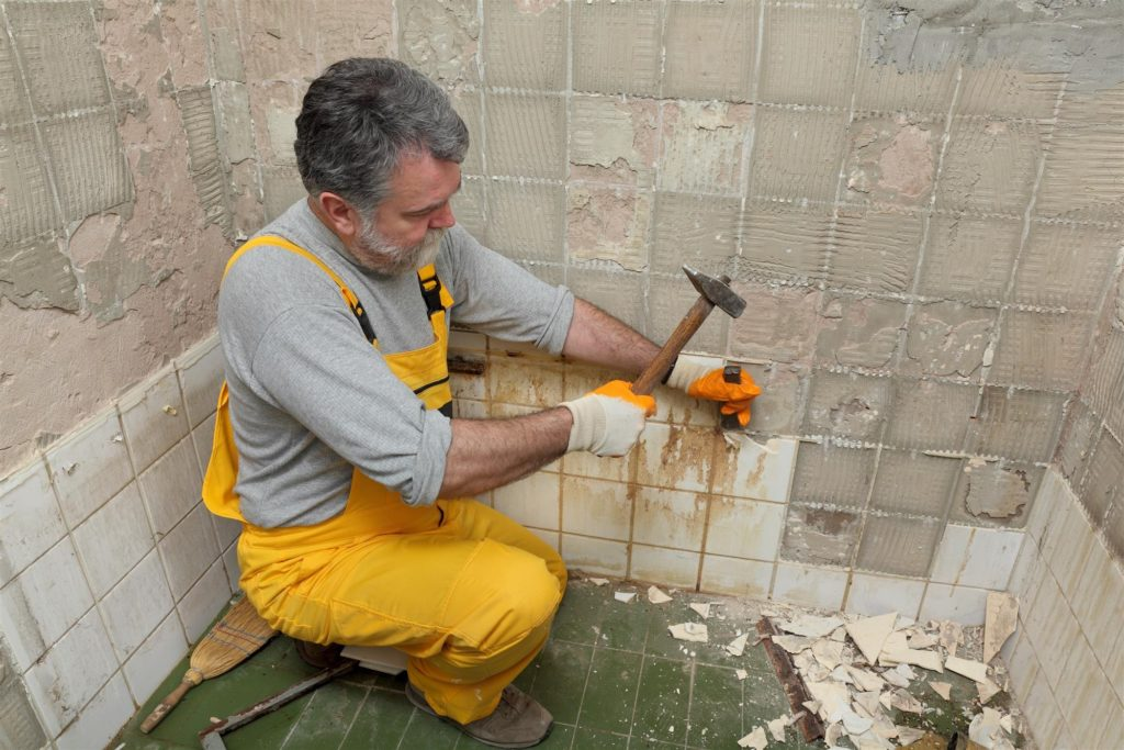 Man Remodeling Odd Shaped Shower