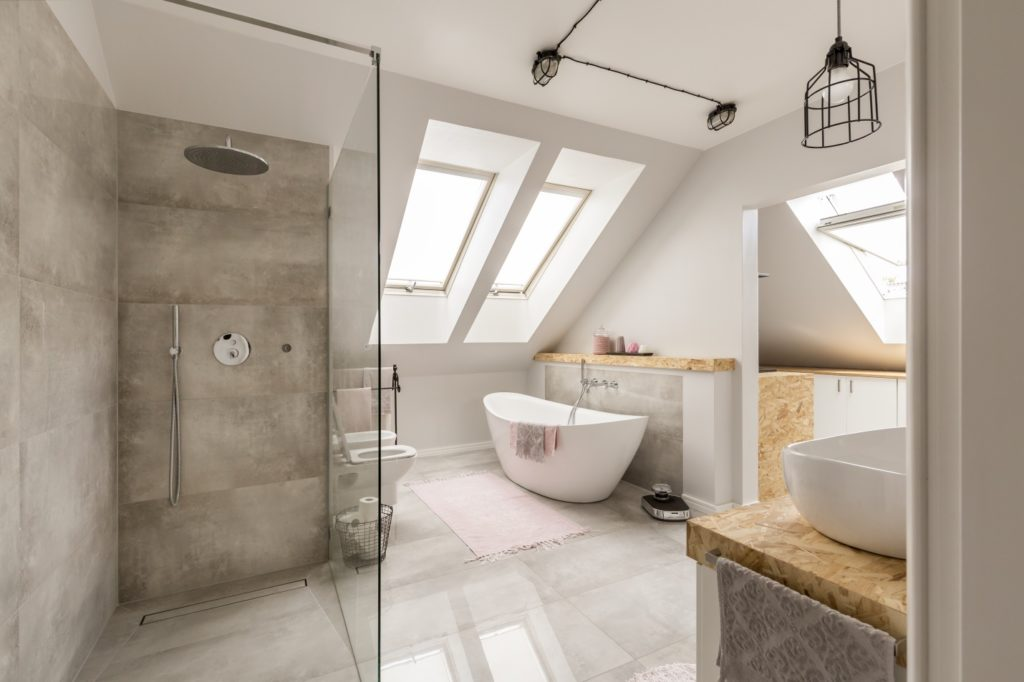 bathroom interior with minimalistic shower and white toilet sink and bathtub
