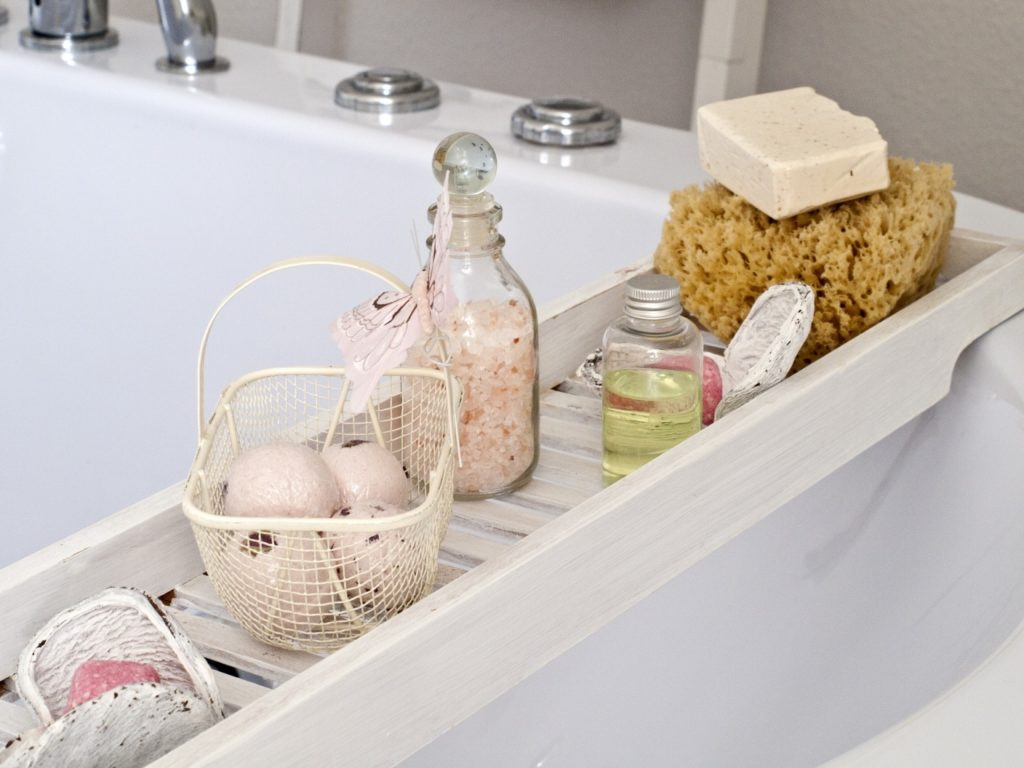 photo of a bathroom with bath bombs and bottles