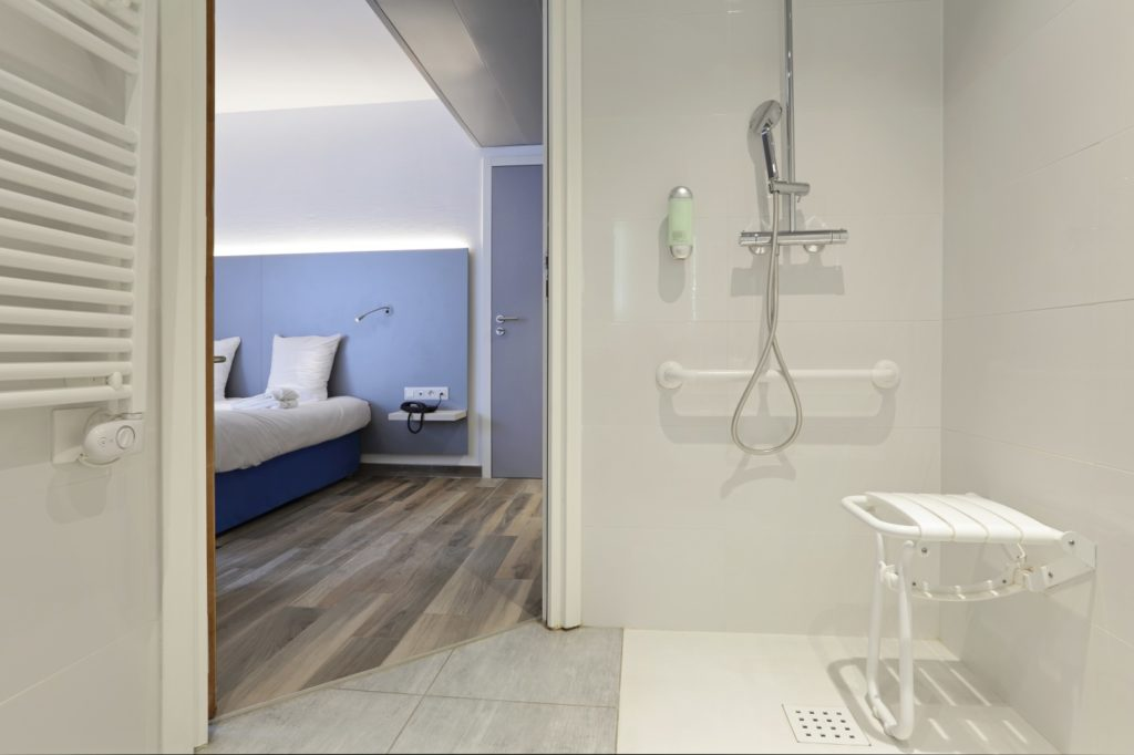 bathroom shower equipped for disabled people