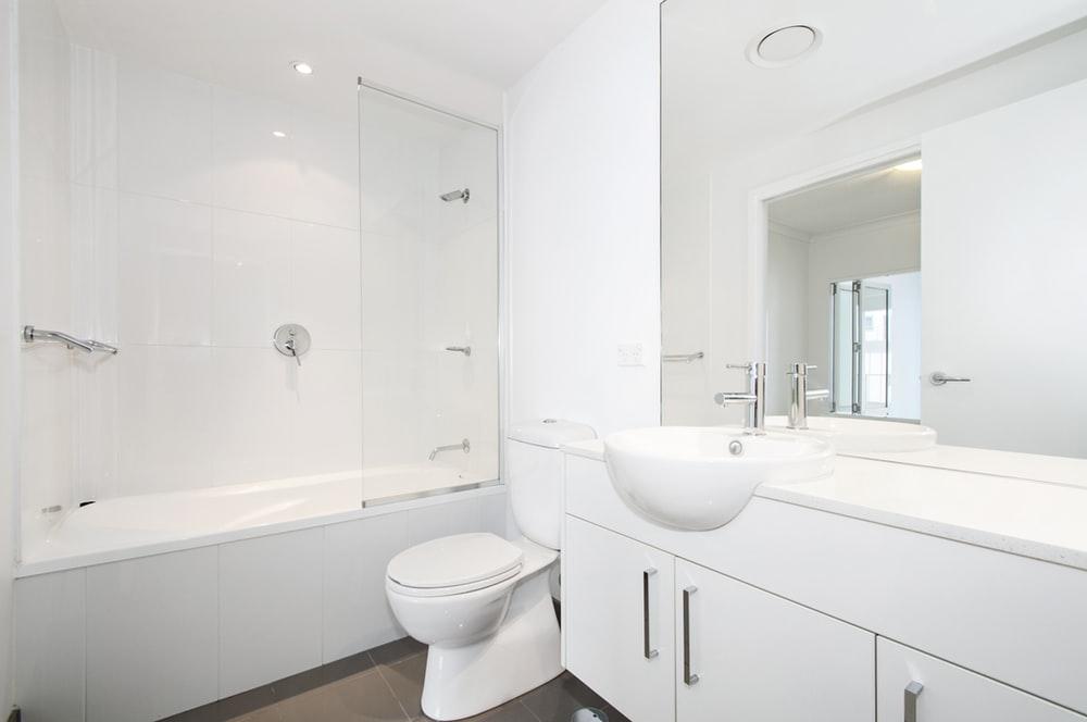 Luxury bathroom interior with an bathtub with glass shower