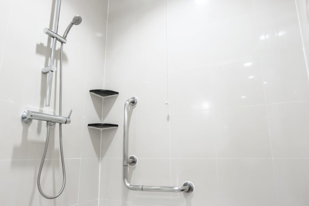 Toilet shower and handrail for elderly people