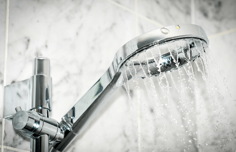 modern shower with water pouring