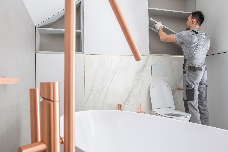 Bathroom Storage Building by Caucasian Home Improvement Worker
