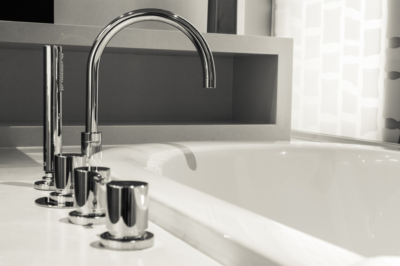 closeup faucet and bathtub in bathroom