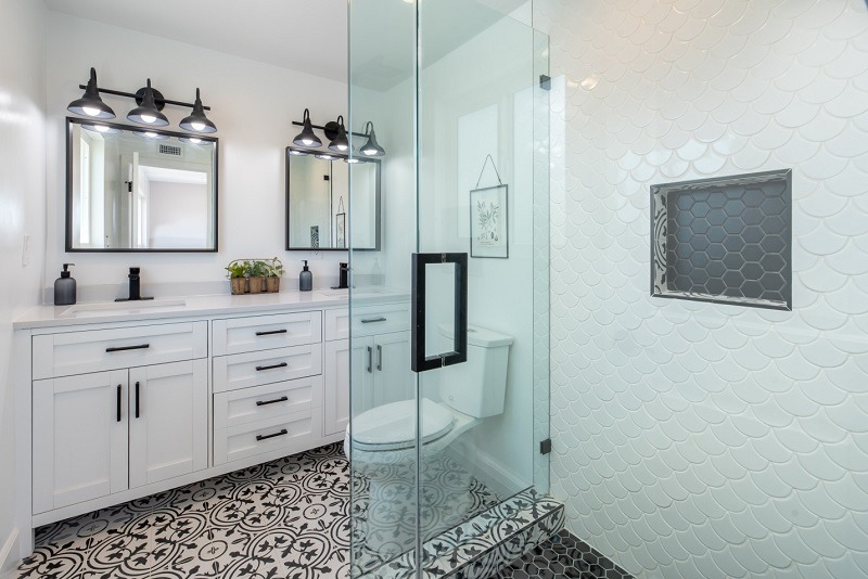 White Toilet, Mirror with White Sink and Towels Glass Shower Door