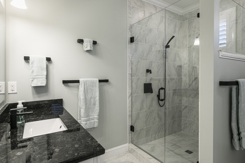 white bathroom with shower box and White Sink