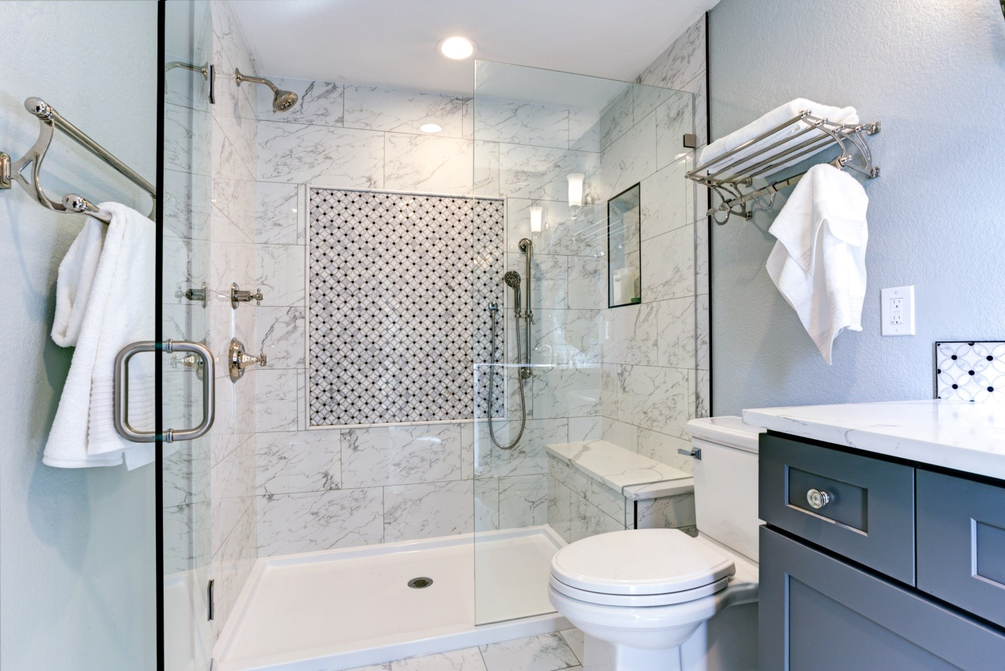 blue bathroom design with Marble shower Surround and mosaic accent tiles