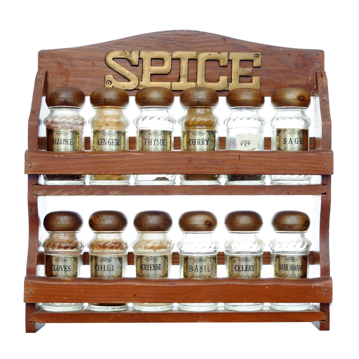 An old wooden spice rack isolated on white background