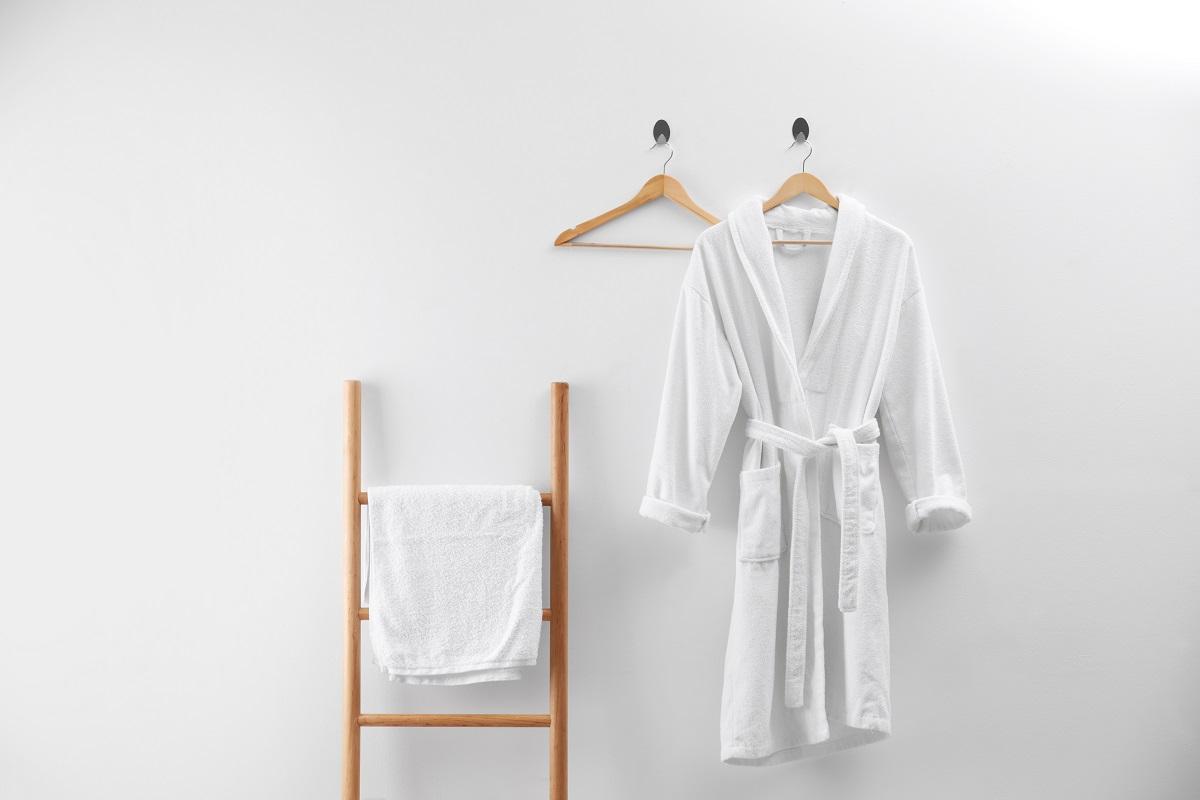 Soft comfortable bathrobe and fresh towel indoors