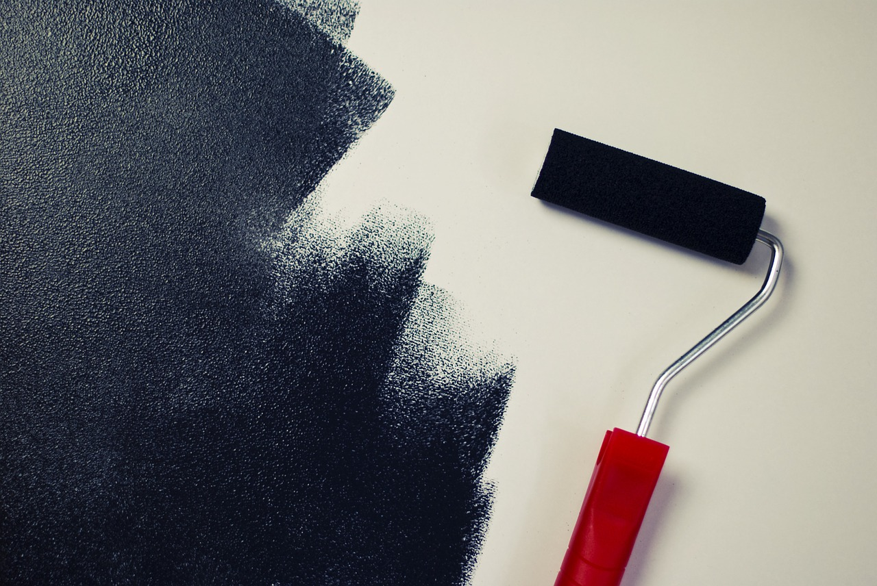 painting the wall with a brush roller